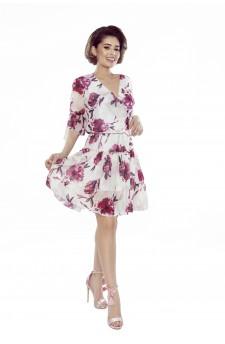 Tiulowa sukienka z falbanami i rozcięciami na ramionach